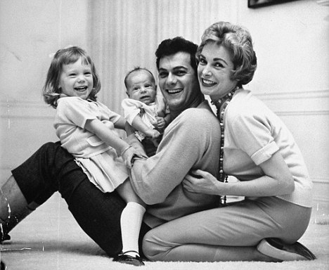 Happier times: Tony Curtis and first wife Janet Leigh pose with their daughters Kelly and Jamie Lee