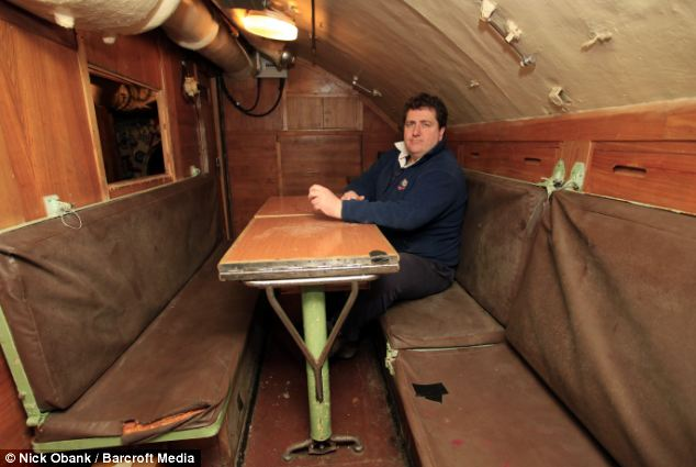 All at sea: John Sutton in the officers' quarters. When Russia sold the submarine it was decommissioned so it could not be used as a weapon of war against them
