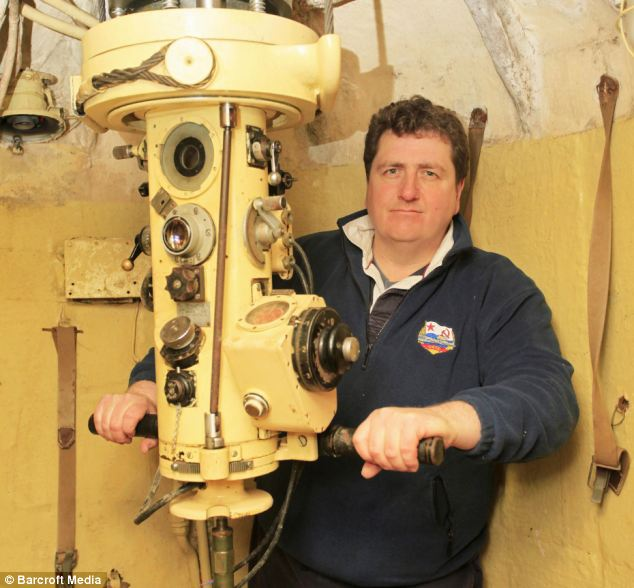 Up periscope! The sub's manager John Sutton gets to play with his very own nuclear submarine, and says he is looking for help to refurbish her