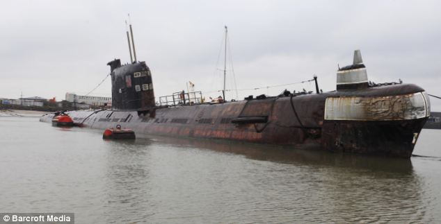 In the shallows: The Russian Foxtrot submarine is now docked on the River Medway in Kent