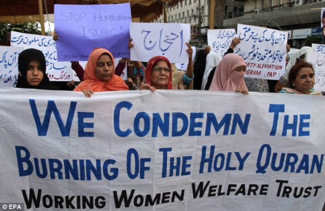 Pakistani women shout slogans during a protest against the controversial US Pastor Terry Jones, in Karachi, Pakistan today