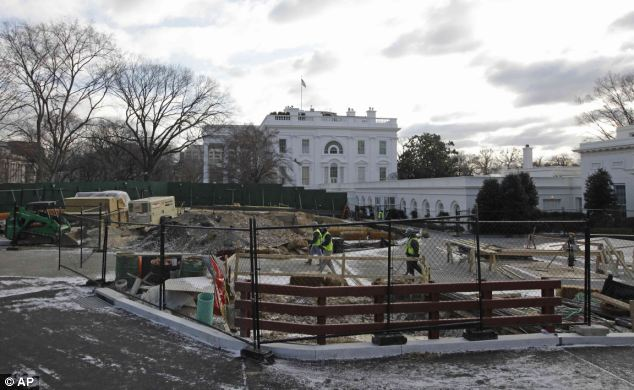 'Big dig': This picture was taken in spring 2011, showing a large green barrier around the iconic Washington building in the background
