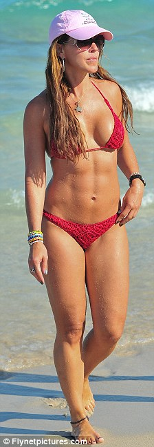 Loving herself: The reality star paraded in a red crochet bikini