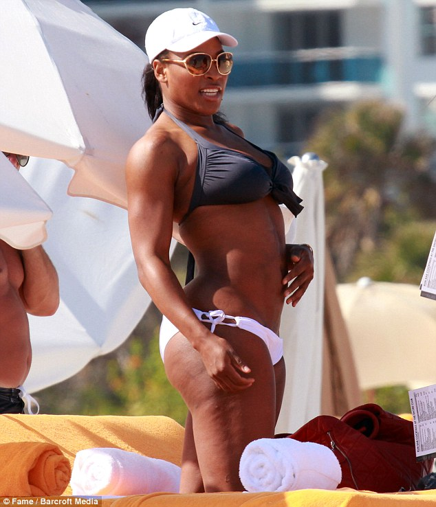 Bikini girl: Serena Williams shows off her curves as she poses in a grey bikini top and white shorts on the beach in Miami after her long injury lay-off