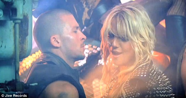 Leather studded Spears: Britney is every inch the rock chick as she gets up close and personal with a male dancer
