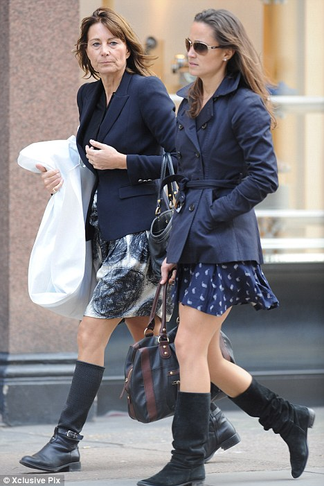 Two of a kind: Carole and Pippa Middleton kept in step as they wore almost identical outfits when they indulged in a spot of retail therapy in Chelsea