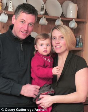 Alan and Sarah Beesley, with their daughter Ellen, inside therr converted barn that they may be forced to pull down