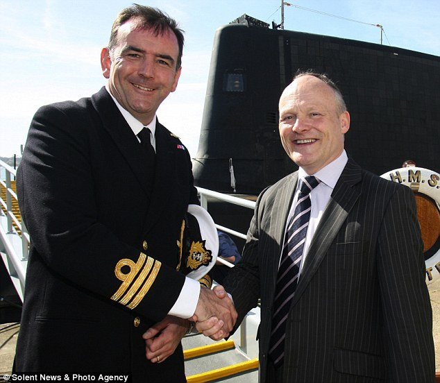 Hero: Councillor Royston Smith with Commander Breckenridge alongside HMS Astute