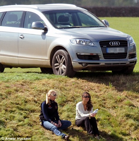 Kate Middleton and a friend watch a polo match as an Audi 4x4 sits on top of the hill. Miss Middleton has previously bought an A3 model