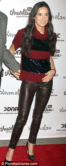 Yummy mummy: Demi looks fab in her leather trousers and killer heels