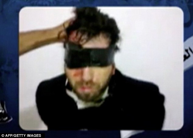 Peace activist: Vittorio Arrigoni - bloodied and bound - in a screengrab from the Jihadist's YouTube video