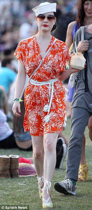 Retro style: Dita Von Teese looked sweet in an orange and white printed dress and espadrille wedges teamed with a sailor hat