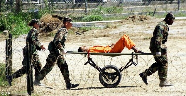 Intelligence gains: Military Police at Guantanamo Bay bring a detainee, who arrived at the camp injured, to an interrogation room