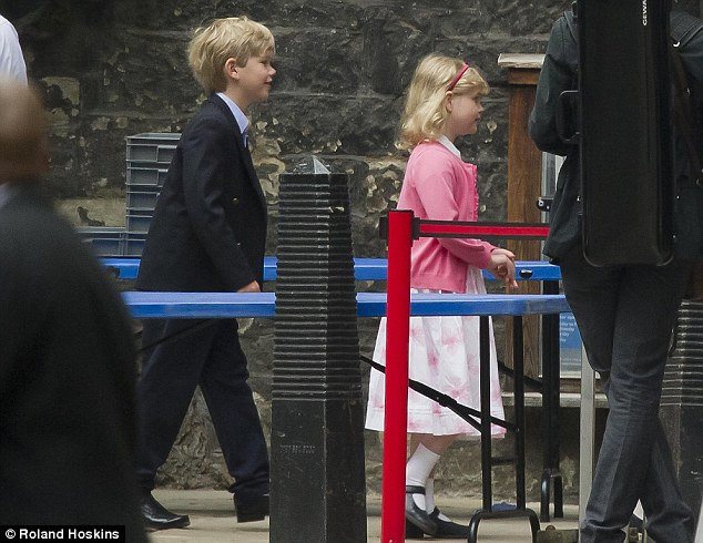 By Royal Appointment: Page boy Tom Pettifer, eight, and Lady Louise Windsor arrive for the rehearsals this morning