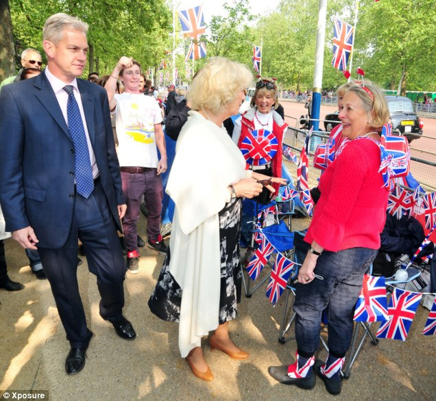 Flying the flag: The Duchess of Cornwall greets royal fans as she arrives at Clarence House earlier today
