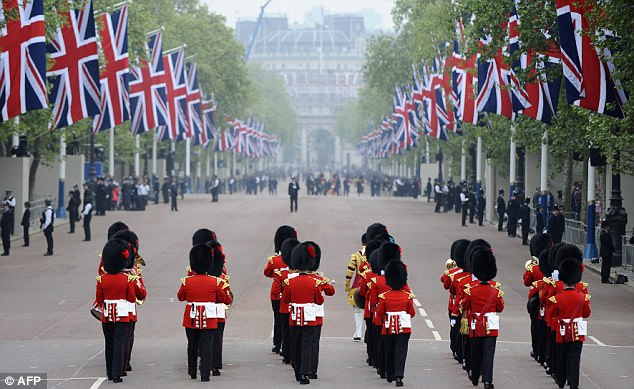 The day is here: A military band perform as they march on the Mall this morning hours before William and Kate marry at Westminster Abbey