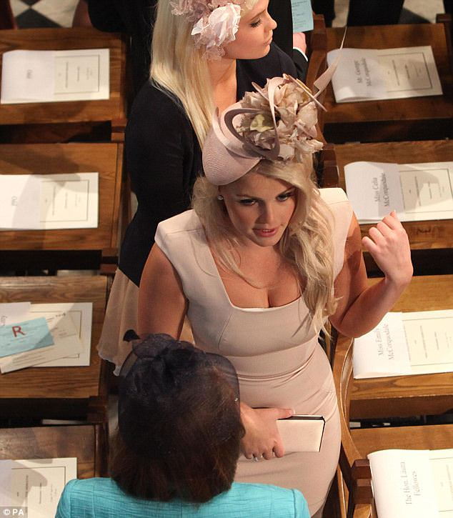 Plunging: Earl Spencer's daughter Kitty reveals perhaps more than she bargained for as the overhead camera angle captures her cleavage in her daringly low-cut Victoria Beckham dress