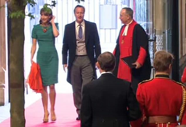 PM David Cameron and wife Samantha, he in morning suit, she in vivid emerald sheath dress with orange scarf and nude heels - and noticeably lacking a hat