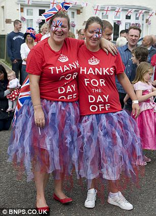 Dressed for the occasion: Two women wear 'Thanks for the day off' Royal Wedding t-shirts