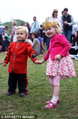 A couple of young royal fans get in the party spirit in Bucklebury