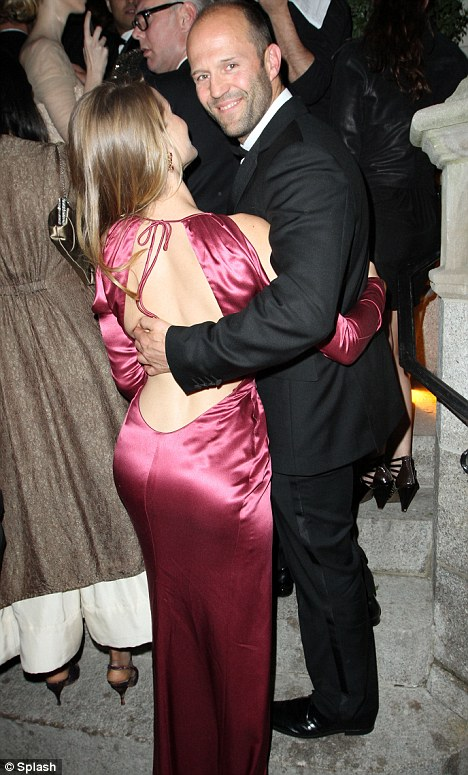 Cheeky: After their embrace, Jason flashed a cheeky smile at photographers