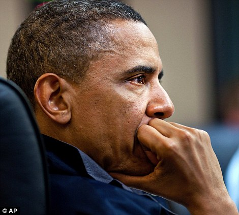 His fist to his mouth, Mr Obama stares intently at the screen showing Bin Laden die