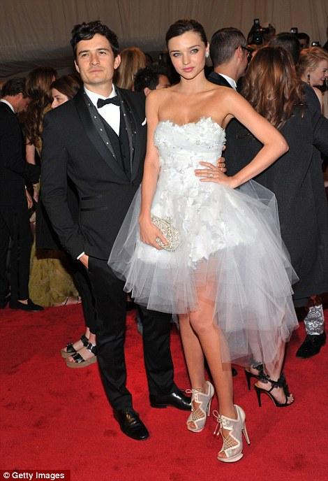 Good-looking duos: Orlando Bloom accompanied wife Miranda Kerr, in a ballerina-style dress by Marchesa