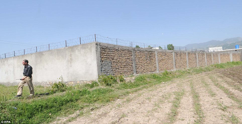 The wall surrounds the compound which was raided in 2003 by security services searching for an Al Qaeda Faraj Al-Libi
