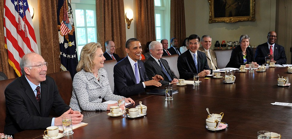 It's a good day: President Barack Obama, centre, holds a jovial Cabinet meeting at the White House today