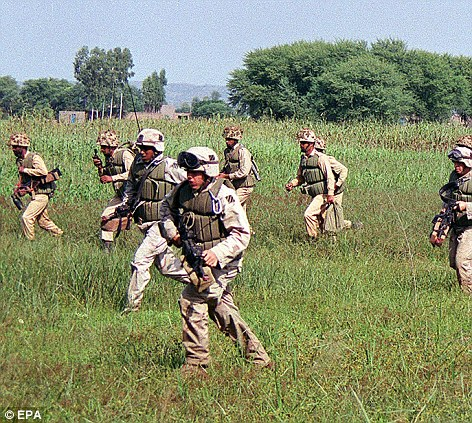 Pakistani and U.S. soldiers take part in a joint exercise in 2002 - similar to the ones they would have carried out together in 2008, just yards from Bin Laden's compound