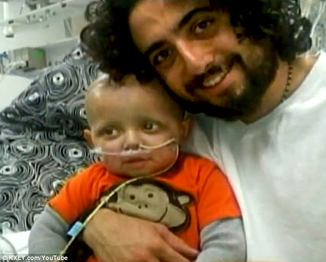 Mike Hyde with his son Cash who was diagnosed with a severe brain tumour
