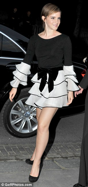 Fashionista: Emma showed off her enviable figure in the flirty outfit, which she teamed with on-trend slicked back hair