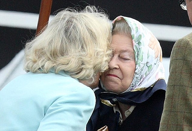 In-laws: Queen Elizabeth greets the Duchess of Cornwall... but the embrace looked a little bit awkward