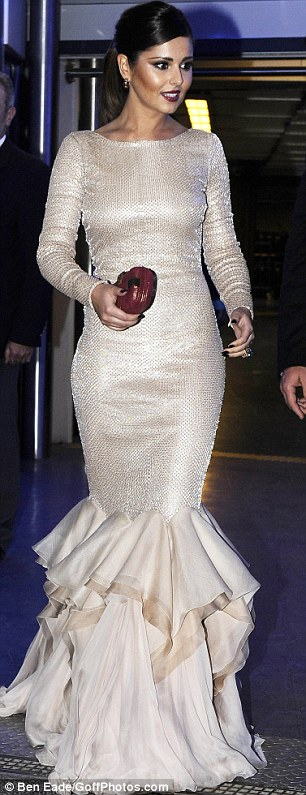 The lady is a vamp: Cheryl Cole turned heads as she arrived at a L'Oreal party during the Cannes Film Festival