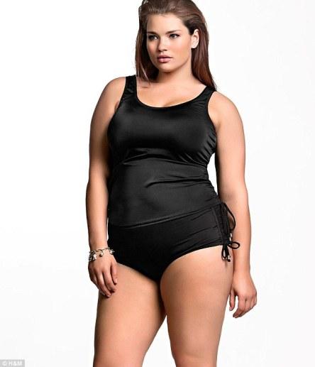 Curves ahead: Tara Lynn models a black tankini for the new Big is Beautiful range by H&M