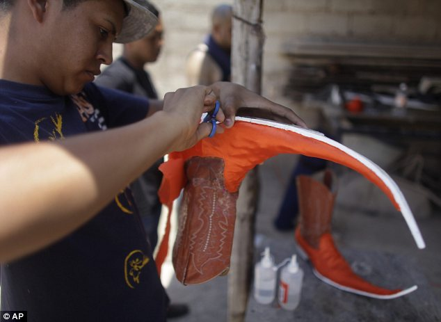Sole trader: Young Mexican men create their own pointy boots in preparation for a dance competitionSole trader: Young Mexican men create their own pointy boots in preparation for a dance competition