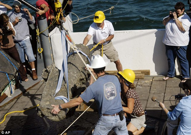 Team effort: Another cannon was raised from the seabed wreckage in October 2007 near Morehead City, North Carolina