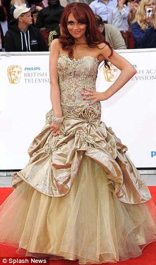 Stealing the show: But it was Amy Childs who stood out from the crowd in her Pia Michi gold gown