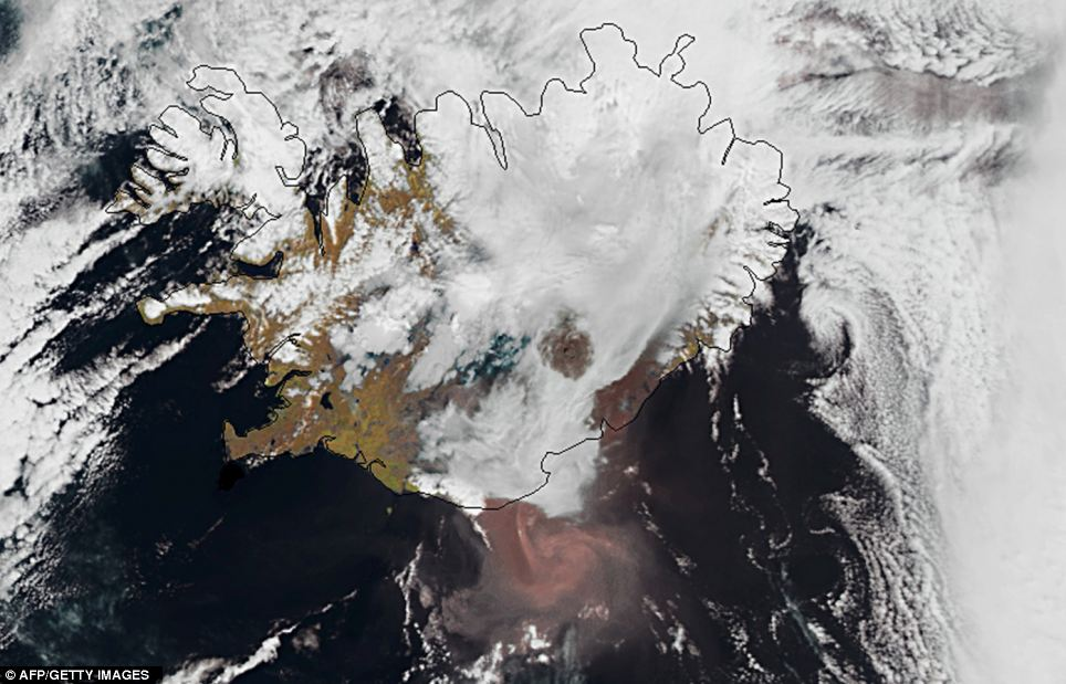 An image taken yesterday shows the ash cloud (reddish colour) moving south from Grimsvotn, Iceland's most active volcano