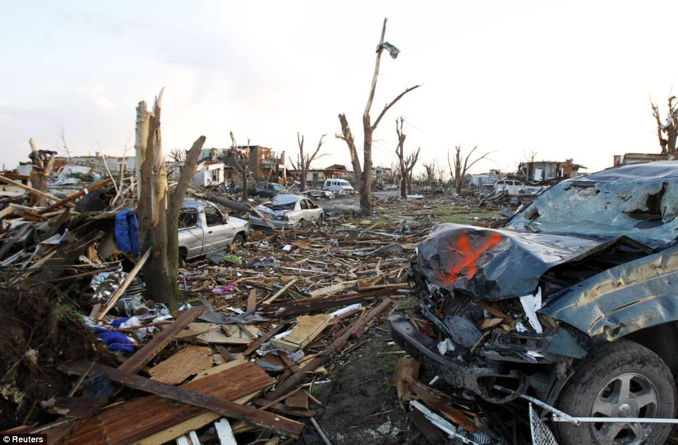 Raised to the ground: Blocks of homes lie in total destruction after the devastating tornado