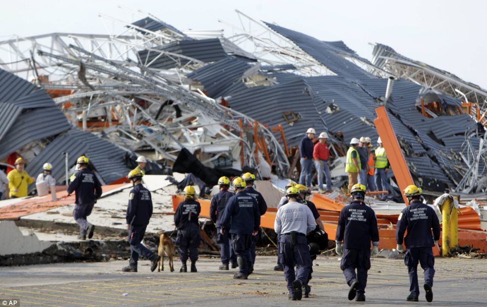 Flattened: Members of Missouri Task Force One search-and-rescue team work at the tornado-damaged Home Depot store in Joplin