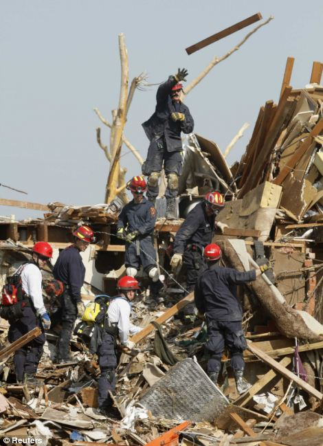 Shock: Joplin residents are still coming to terms with the loss of their homes as rescue workers continue efforts to find survivors