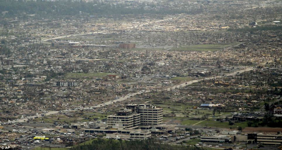 Wasteland: The horror of Sunday's tornado is laid bare by this harrowing panoramic shot of Joplin