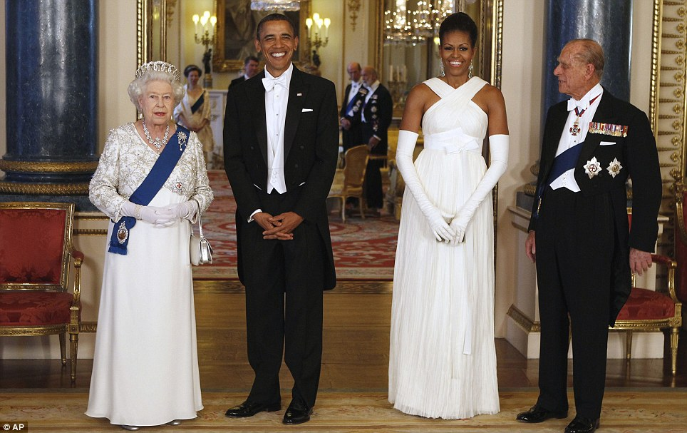 Dinner for 171: The lavish banquet, hosted by the Queen, was to honour the Obama's state visit, and the President and First Lady posed here with the Royal couple before enjoying their meal