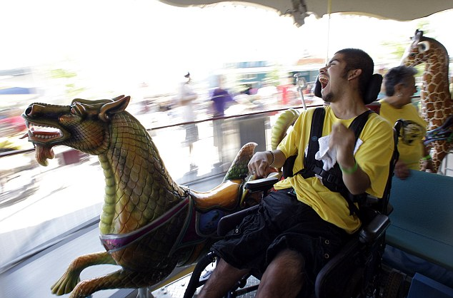 Fabian Mendoza whoops with delight as he rides a carousel at Morgan's Wonderland. The disabled are allowed into the park for free, while tickets for those with them cost just $10