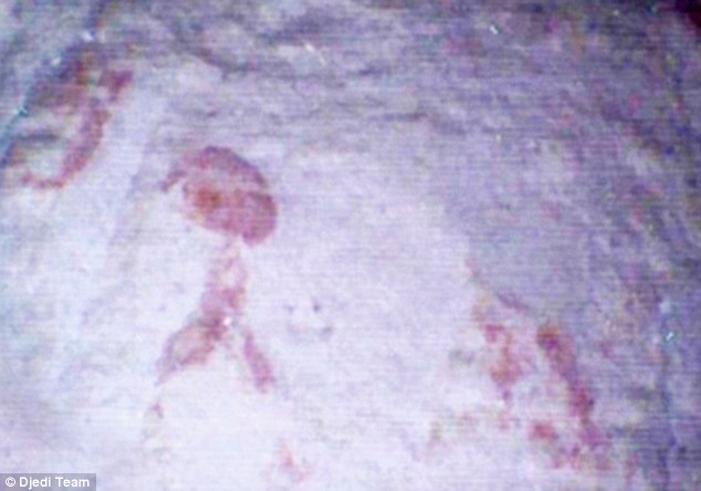 Mystery markings: A close up view of the red figures on the floor behind the first blocking stone in the tomb