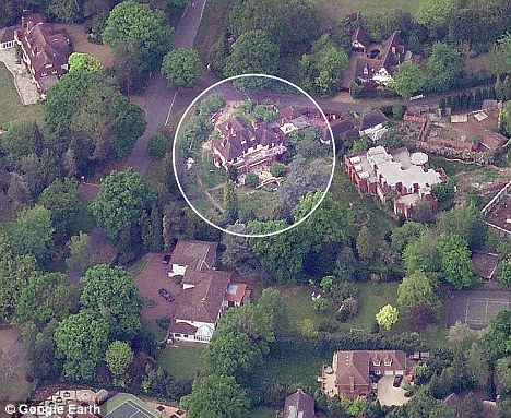 Ideal home: Woodlawn Cottage (circled) is one of many luxury homes on the private estate