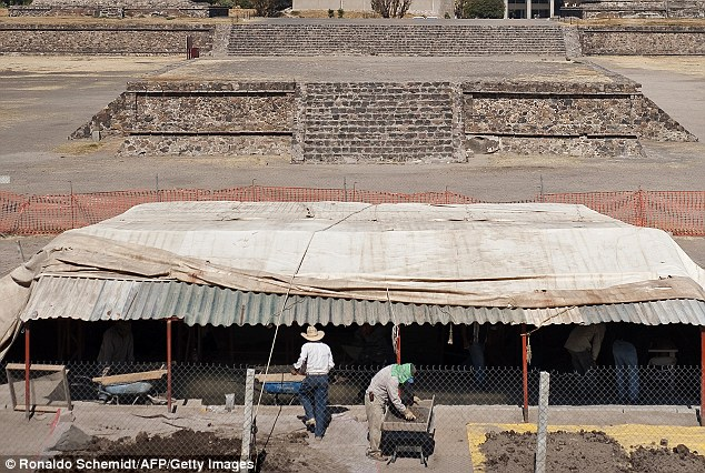 Digging deep: Skilled workers search for archaeological pieces among remains from an excavation at the Temple of the Feathered Serpent