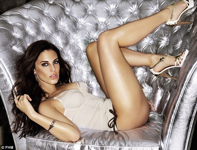 Taking the weight off: The 22-year-old was sizzling in a basque putting her feet up in a silver chair on the shoot