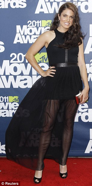 Magical: Twilight star Nikki Reed wore a black dress complete with a veiled section and, right, Amber Lancaster